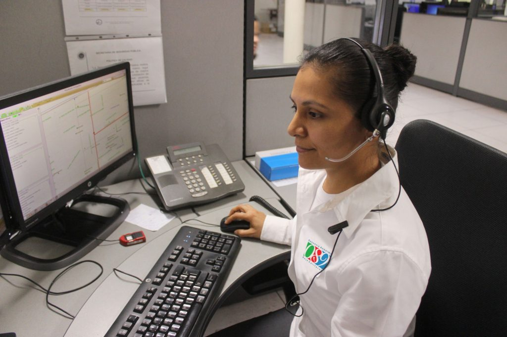 This is the main photograph for the business phone systems category page. It shows a female employee answering a telephone call using a head set.