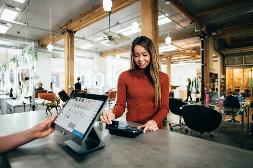 This is the main photograph for the Guide to the best UK merchant accounts article. It shows a shopper making a card payment.