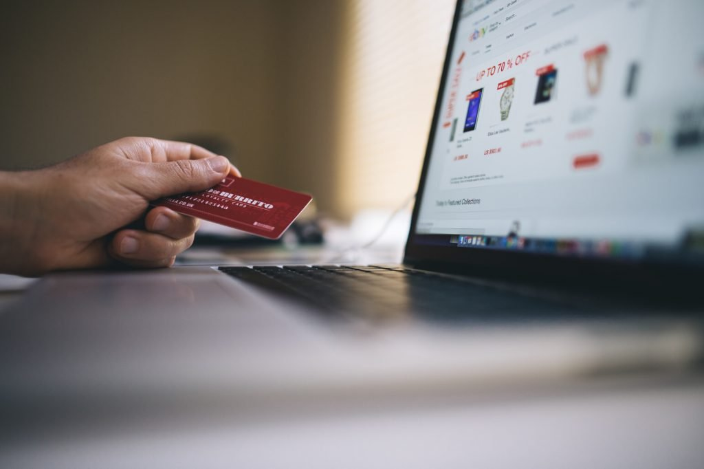 This is the second photograph for the How to accept card payments article. It shows an open laptop and person holding a credit card ready to make online card payments.